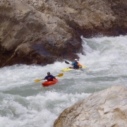Kayaking Harkapur rapids (Class V) on Sun Koshi river, Nepal.